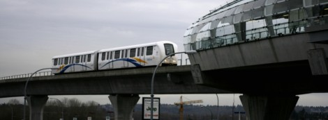 2-car SkyTrain approaches Brentwood Station on the Millennium Line