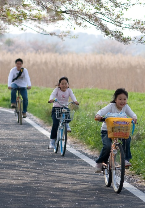 A group of kids cycling in Japan