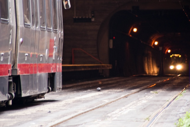 A MUNI Metro train exits the downtown tunnel