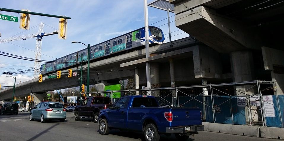 A Canada Line train pulls into Marine Dr Station - photo by Larry Chen, license obtained