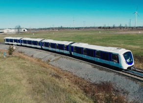 Photo of a 4-car train on the test track in Kingston, Canada